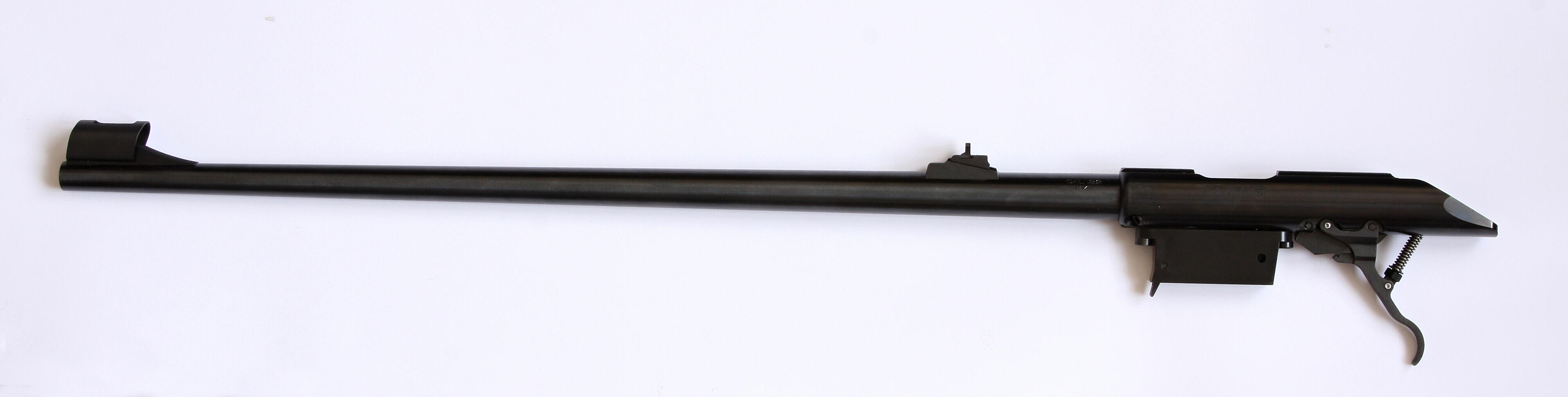 Pouzdro závěru s hlavní, zásobníkovou šachtou a spoušťovým  mechanismem.